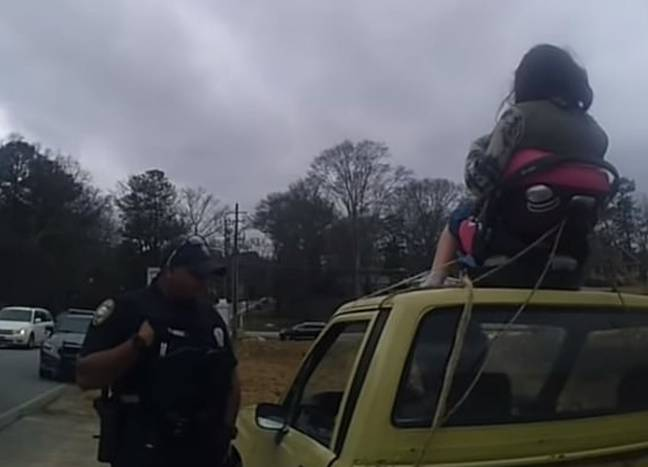 The police stopped Borat after someone reported seeing a woman strapped to the top of his car. Credit: Lilburn Police Department