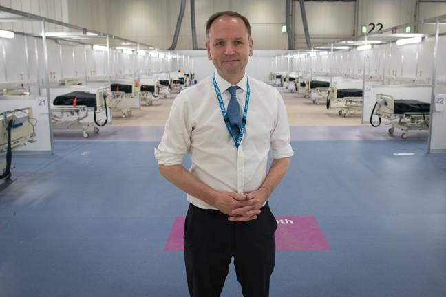 NHS England's chief executive Simon Stevens during a visit to the ExCel centre. Credit: PA