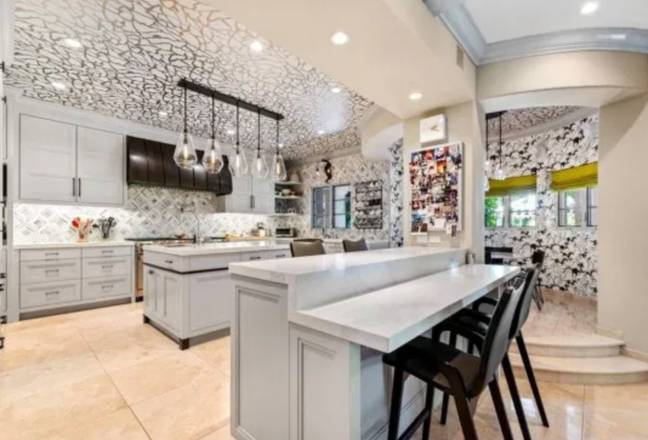 Amongst other things, the property has a movie theatre, a lavish master suite with three walk-in closets and a huge chef's kitchen. (Credit: Keller Williams Realty)