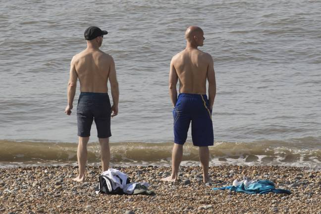 Two men on the beach today. Credit: i-Images Picture Agency