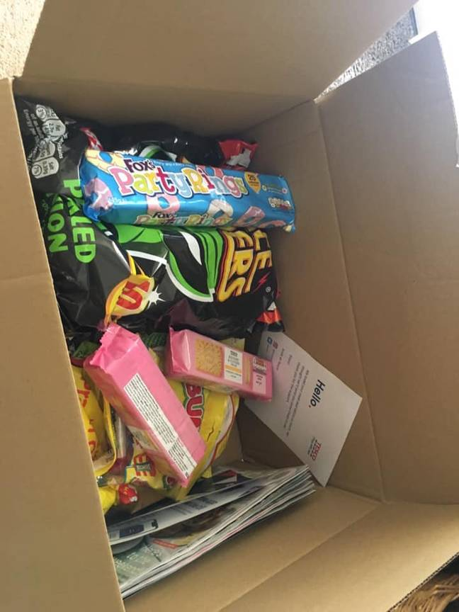 To say thank you they sent Lizzie a box of crisps, sweets and biscuits. Credit: LADbible