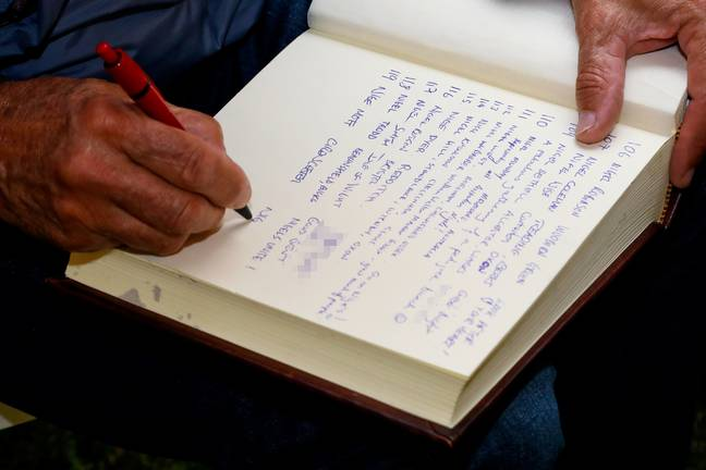 Nigels signed 'The Book of Nigel' so Guinness can ratify their world record attempt. Credit: SWNS