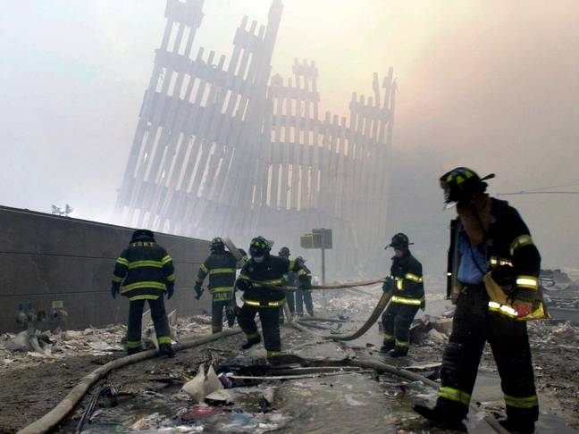 Firefighters and volunteers searching for survivors in the aftermath of the collapse of the twin towers. Credit: PA