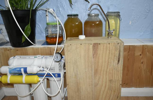 Fabian Farquharson ages some of his urine for up to a month before drinking. Credit: SWNS