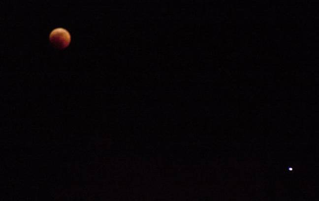 Blood moon with Mars on the bottom right (white dot) in Nairobi on Friday, July 27. Credit: PA