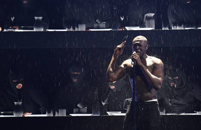 The rapper criticised Theresa May for her reaction to Grenfell at the BRIT Awards. Credit: PA