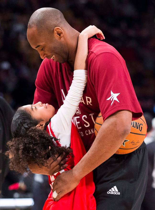 Kobe Bryant hugs his daughter Gianna on the court. Credit: PA