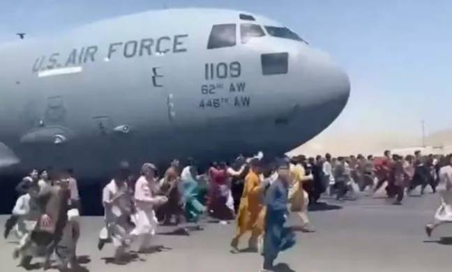 Hundreds of people clung onto the plane as it left Kabul. Credit: Twitter