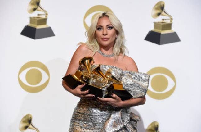 Lady Gaga with her Grammy Awards. Credit: PA