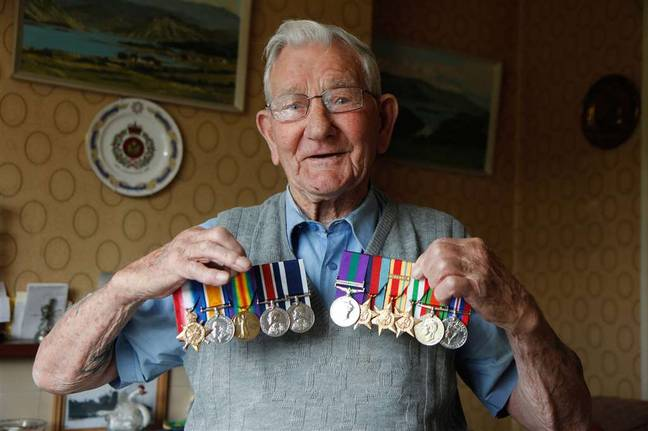 Stelfox posing proudly with his medals. Credit: SWNS