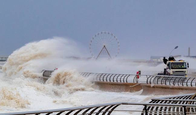 Waves crash over a lorry on Blackpool waterfront. Credit: PA