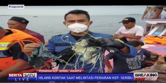 Debris 'suspected' to be from the aircraft has been pulled from the sea. Credit: Berita Satu