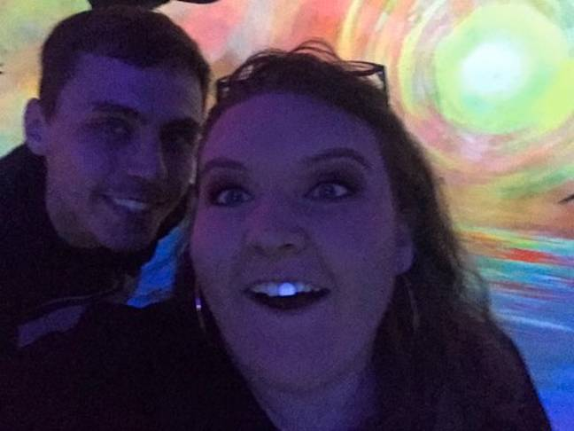 Megan Maunsell with her denture lit up by a backlight - pictured with her boyfriend Kieran Allen. Credit: Kennedy News and Media
