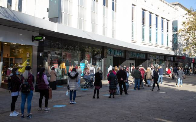 Shoppers queuing up outside Primark in Portsmouth yesterday. Credit: PA
