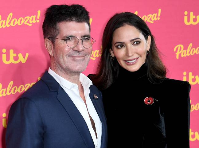 Simon Cowell and Lauren Silverman. Credit: PA