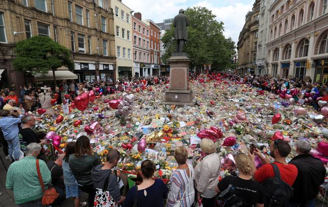 Flowers and tributes left in St Ann's Square. Credit: PA