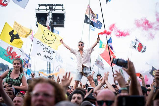 Want to get paid £5,000 to go to a festival? Credit: PA