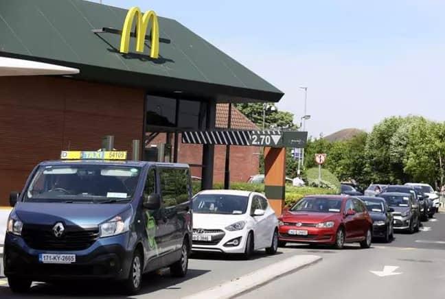 Customers queue in Peterborough. Credit: PA