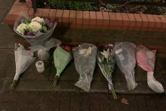 Flowers have been left outside the flat. Credit: GoFundMe