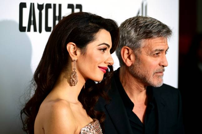 George Clooney with his wife Amal. Credit: PA