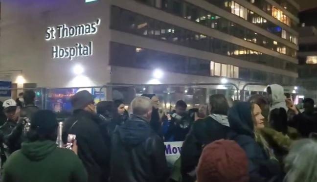 Covid deniers were seen chanting outside a hospital in London on New Year's Eve. Credit: Twitter