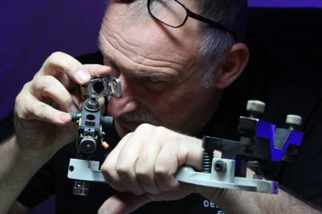 A worker shows the diamond polishing techniques. Credit: PA