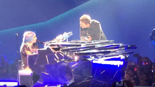Lady Gaga and Bradley Cooper on stage in Vegas. credit: Youtube/Gaga Daily