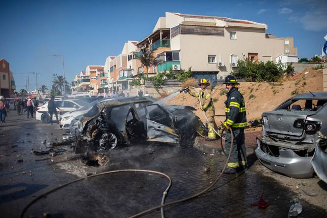 Firefighters extinguish blaze caused by a rocket fired from Gaza Strip towards Israel. Credit: PA
