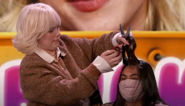 Eilish cutting hair with all the confidence of somebody who has never done it before. Credit: Jimmy Kimmel Live