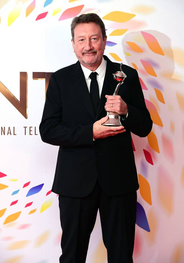 Steven Knight with the award for Best Drama for Peaky Blinders at the 2020 NTAs. Credit: PA
