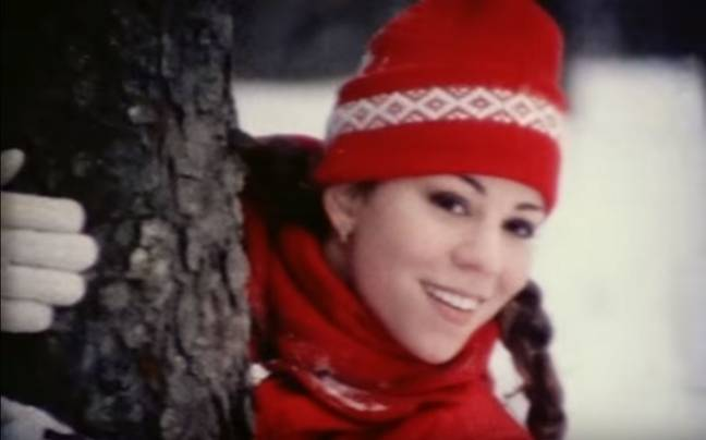 Mariah Carey has released a new video for 'All I Want for Christmas is You' with previously unreleased footage. Credit: Mariah Carey/Columbiait: