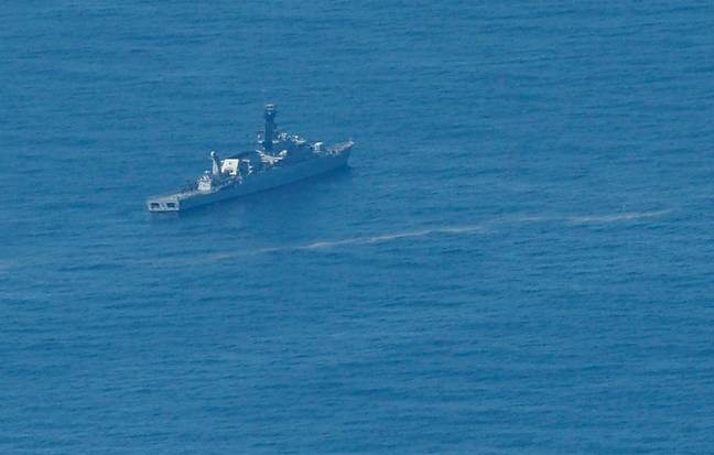 Navy ship searching for the missing submarine. Credit: PA