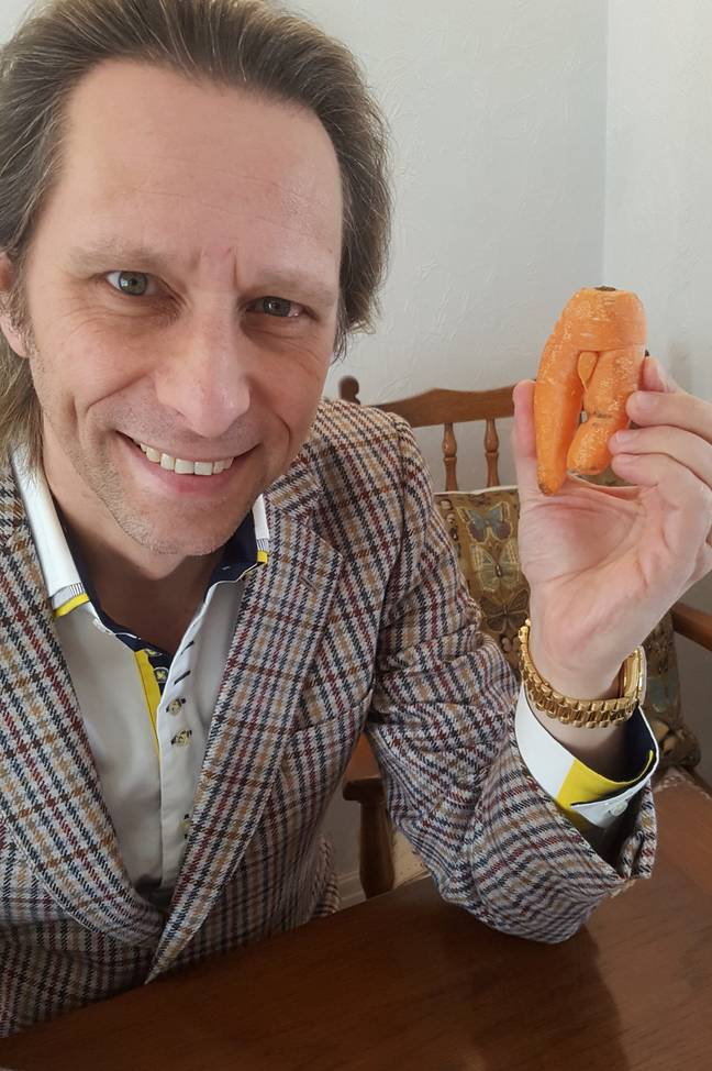 Michael with his beloved carrot. Credit: SWNS