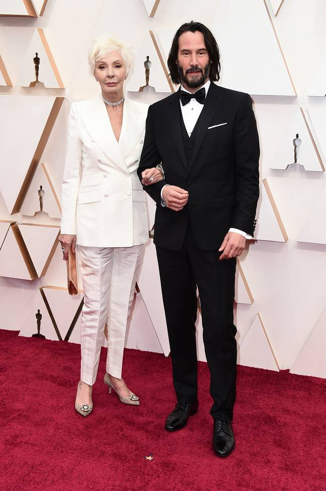 Patricia Taylor, left, and Keanu Reeves arrive at the Oscars. Credit: PA