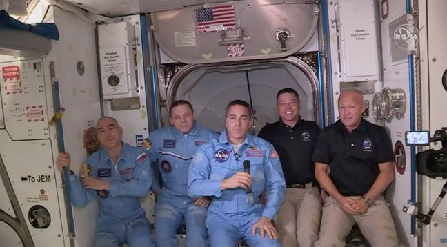Bob Behnken and Doug Hurley, far right, joining the the crew at the International Space Station. Credit: PA