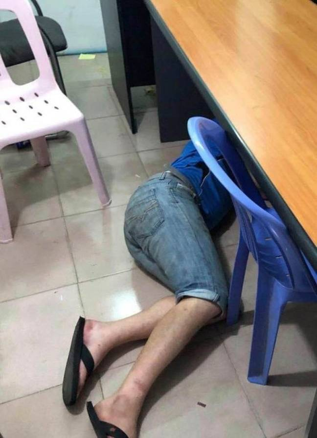 The two men were photographed asleep in the police interview room. Credit: Viral Press