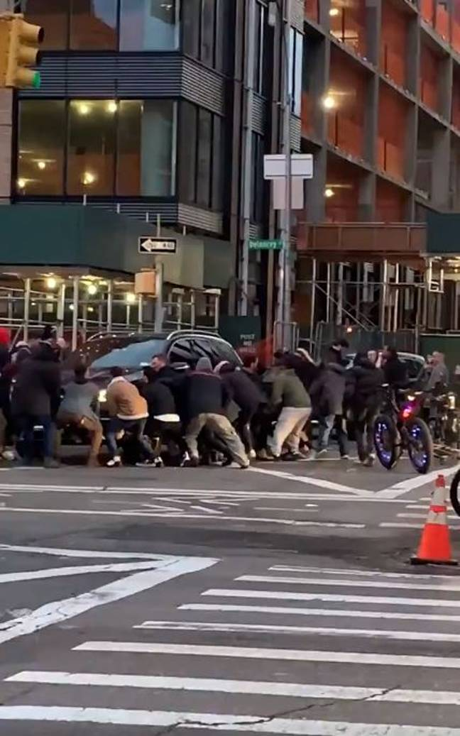 New Yorkers came together to help save a 25-year-old woman out from under an SUV. Credit: Colby Droscher via Storyful