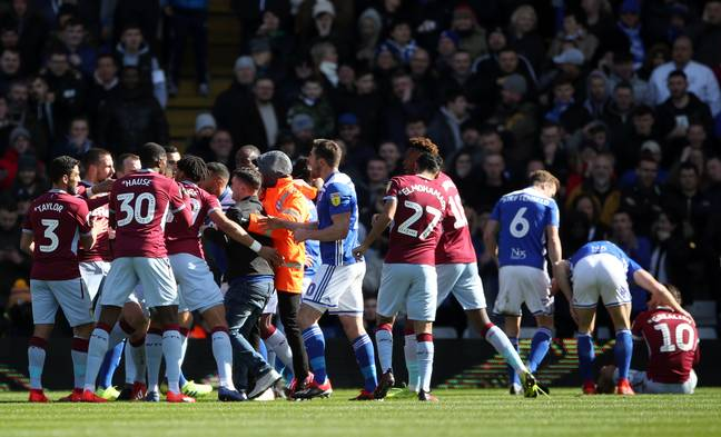 The scene as Mitchell invaded the pitch yesterday. Credit: PA