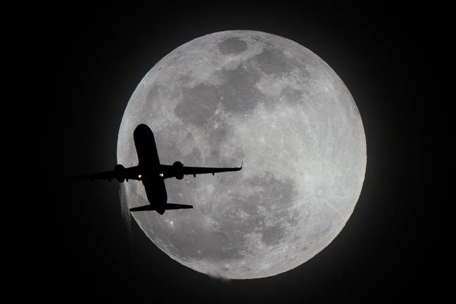 Moon = motionless. Plane = moving. Or is it? Credit: PA