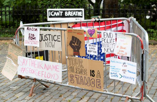 Protest posters outside the US Consulate General office in Edinburgh. Credit: PA