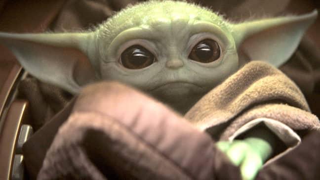 Baby Yoda here, being cute. Credit: Disney