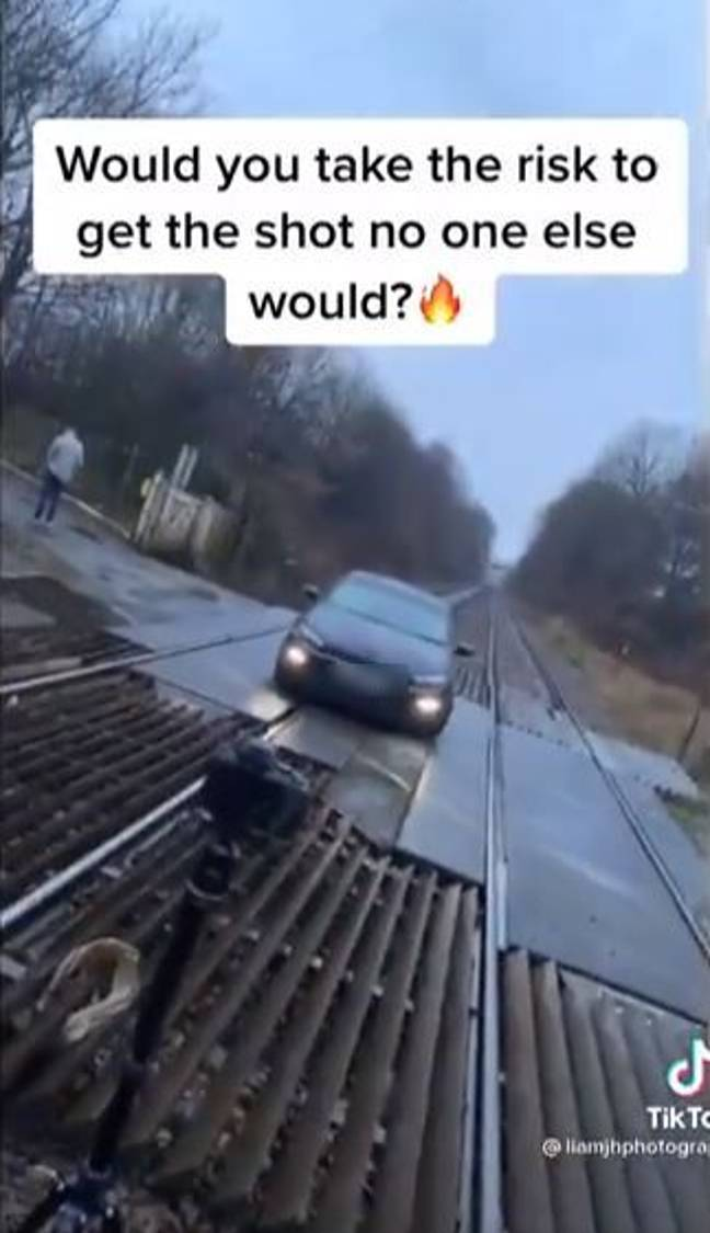 The clip showed the car parked on the the Oaks level crossing, at Bromleys Cross, Bolton. Credit: TikTok