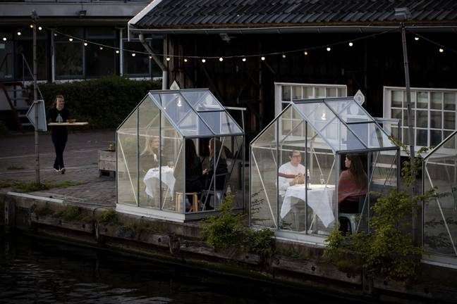 A restaurant in Amsterdam has installed greenhouses for diners. Credit: ROBIN VAN LONKHUIJSEN/ANP/AFP via Getty Images