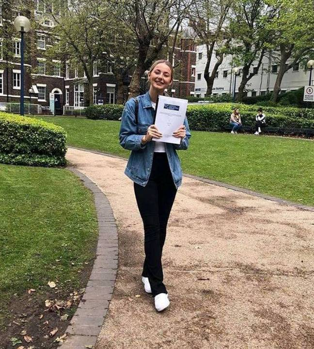 Tait with her dissertation. Credit: SWNS