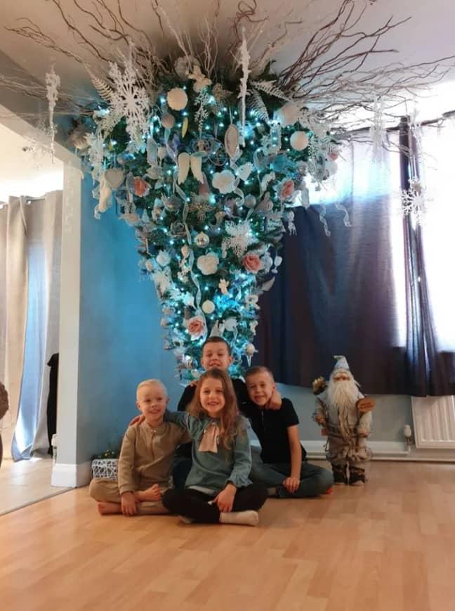 Her kids love the tree. Credit: Kira Darkin-Dias