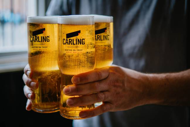 The pint glasses really are at the cutting edge of beer-carrying technology. Credit: Carling