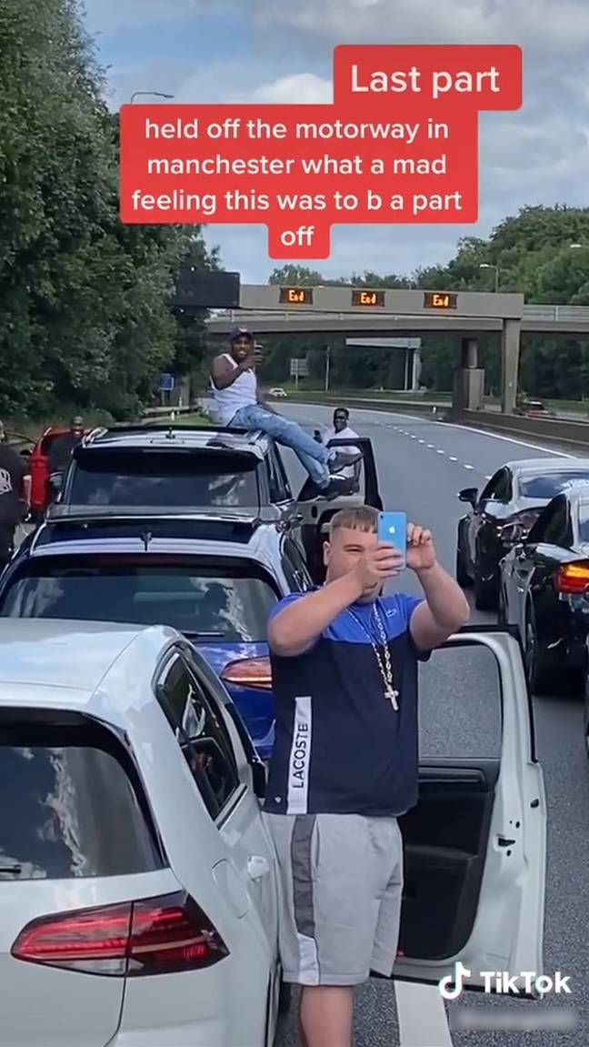 The group of drivers stopped along the M60. Credit: Kennedy News and Media