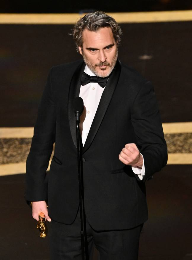 Joaquin Phoenix picking up his award for Best Actor. Credit: Shutterstock