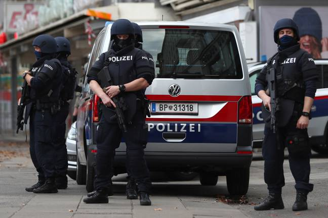 Police officers guard the scene in Vienna. Credit: PA