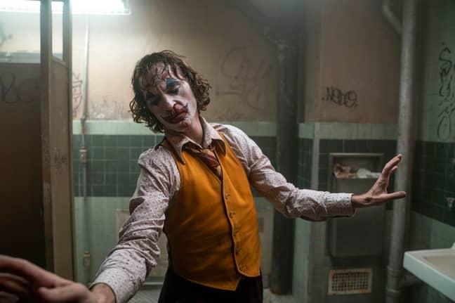 Joaquin Phoenix picks up the Oscar for Best Actor. Credit: Warner Bros